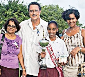 A family affair: Senator Debbie Tobierre (r) beams following a 2012 school  excellence contest with her niece, another relative, and their proud constituency representative the prime minister Kenny Anthony.