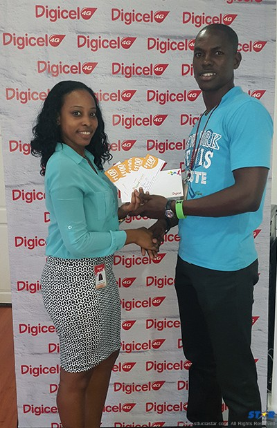 Digicel's Fiona Smith presents Duran Leonce with his winnings.