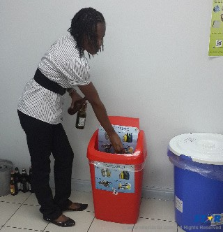 A member of staff putting into practice Reduce, Reuse, Recycle initiative.