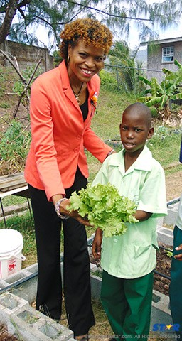 Carol Eleuthere-Jn Marie with student.