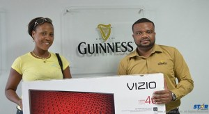 One of the lucky Guinness Winners Certa Fulgence with Guinness Brand Manager Sylvester Henry.