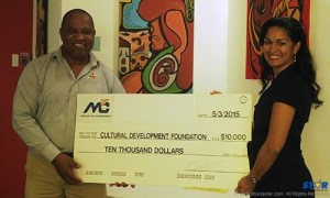Mrs. Marella Devaux, Group Marketing Manager of M&C Group of Companies presenting the donation to Mr. Petrus Compton, Executive Chairman of the CDF.