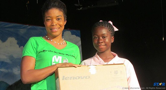 Spelling-Bee-Champ-Darla-Willie-collects-her-Lenovo-Laptop-courtesy-of-Jerry-George