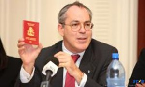 Deputy Prime Minister and Minister of Foreign Affairs  Brent Symonette of The Bahamas holds up a Bahamian Diplomatic e-passport.