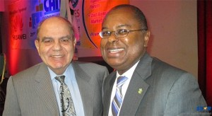 Dr. James Fletcher, ECTEL Council Member for Saint Lucia and Dr. Neil Mackay, Founding Chairman of CANTO in a friendly chat after the Ministerial Roundtable at the CANTO 31st annual conference in Miami on July 27th, 2015.