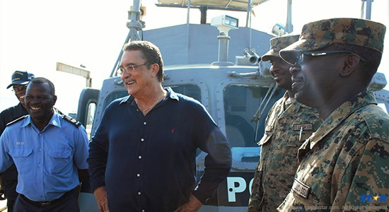 Prime Minister Anthony enjoys a light moment with the crew of the RSLPF vessel Defender.