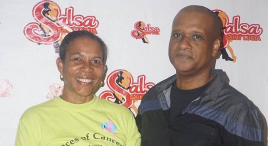 Dorothy Phillip of Faces of Cancer receives a cheque from Peter St. Rose of Salsa St. Lucia.