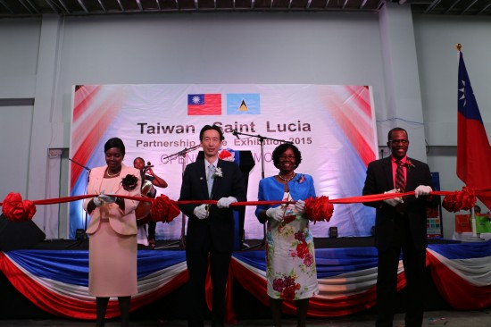 Cutting the ribbon to declare this year's exhibition open: (L:R) Emma Hyppolyte, Minister for Commerce; Ambassador Mou; Governor General Dame Pearlette Louisy and Phillip J Pierre, Minister for Infrastructure.