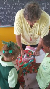 Dentist Neil Stephen demonstrates proper brushing techniques to the children of Gros Islet Infant School during a recent visit.