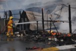 Firefighters tried to bring the fire under control.Fire