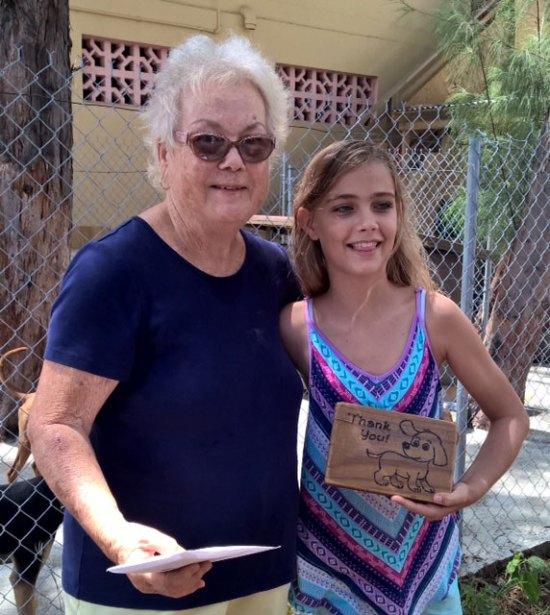 SLAPS President Pam Devaux (left) with kind-hearted dog-lover Athena Werner.