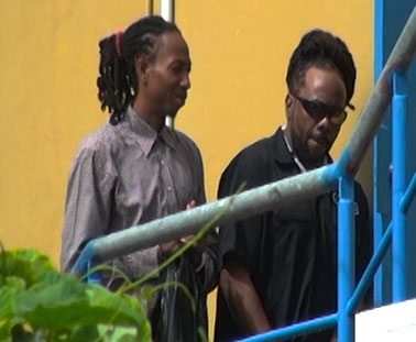 Two of the accused arriving in court.