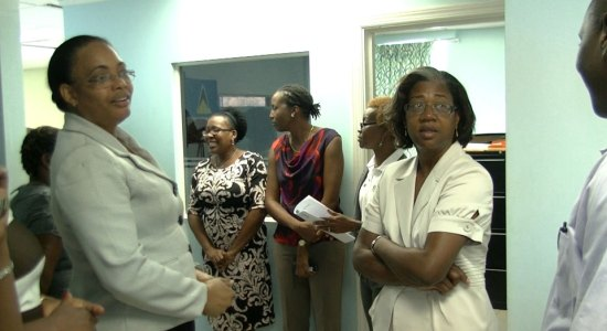 Permanent Secretary in the Ministry of Health Cointha Thomas (left) with staff and Minister of Health Mary Isaac (right).