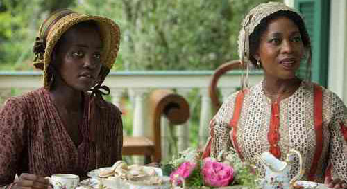 From the movie 12 Years a Slave: Patsy and Mistress Harriet enjoy some tea giving off a facade much like many of our women today who remain shackled by the house slave mentality.