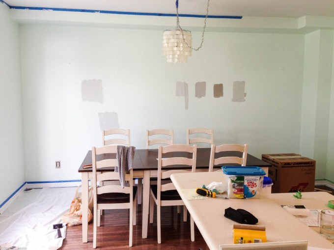 Before: Our dining area in the process of choosing the paint colour for the kitchen.