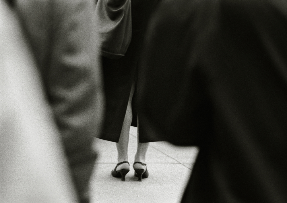 Standing in line, by John Strazza