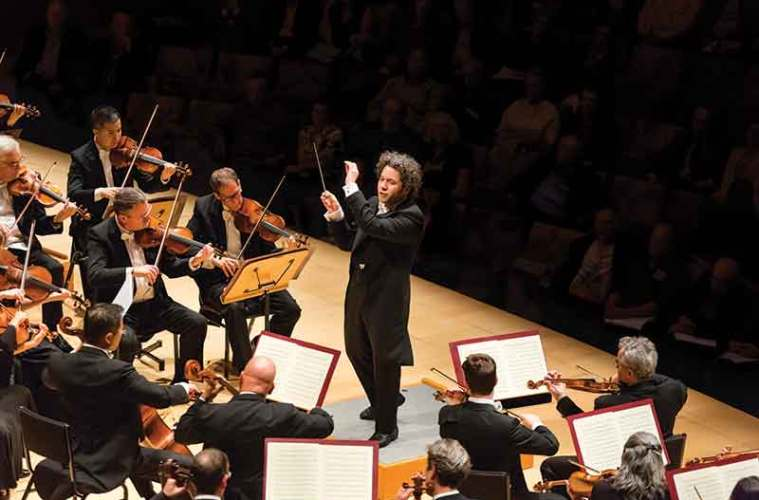 Los Angeles Philharmonic music director Gustavo Dudamel conducting the symphony