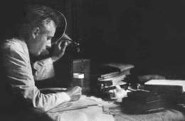 Béla Bartók, composer and ethnomusicologist, reviewing recordings of folk songs on a phonograph