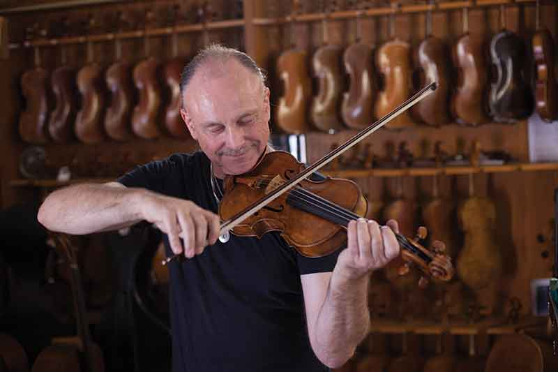 Luthier Michael Fischer, founder of Fisher Violins Shop, est. 1982 in Los Angeles