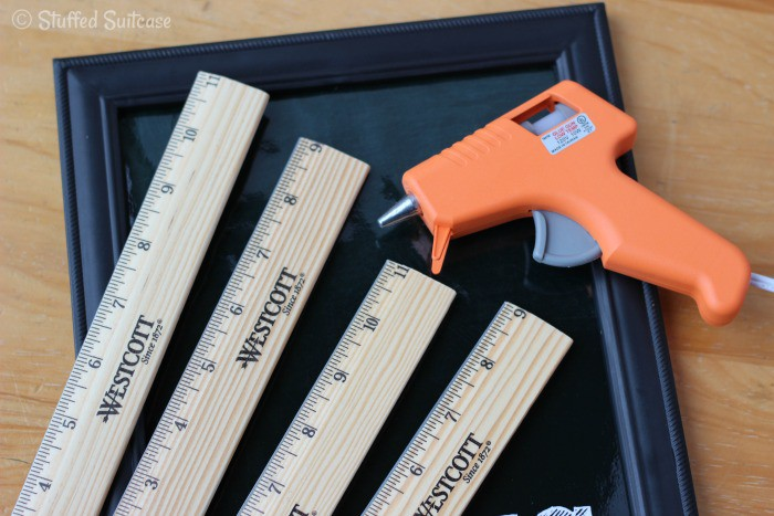 Use glue gun to attach rulers to frame