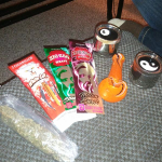 some grinders blunt wraps and a bag of weed