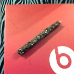 beats by dre and a joint in clear rolling papers