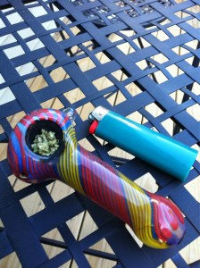 glass marijuana pipe filled with weed