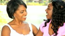 stock-footage-close-up-loving-african-american-mother-daughter-spending-time-together-sitting-garden-bench