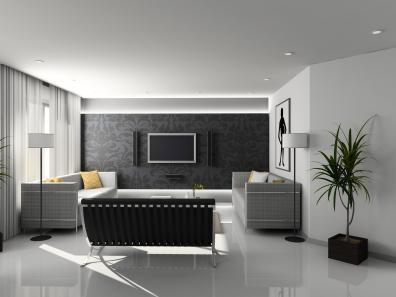 סלון מעוצב בגווני לבן אפור ושחור יוצרים הרמוניה בחדר הסלון.