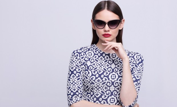 high fashion portrait of young elegant woman in sunglasses.