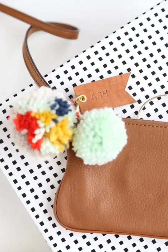 DIY pom pom & leather luggage tags