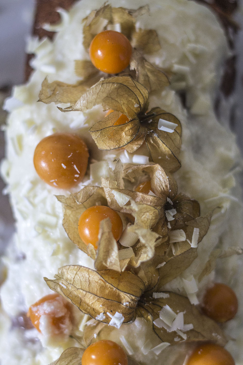 Physalis cake with white chocolate frosting