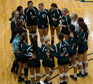 The Rocky volleyball team caught in a moment of happiness as they hold a team huddle after one of their home wins. photo by Brandon Keim