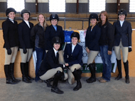A  part of the RMC IHSA team smiles for the camera at one of their competitions. From left to right: Jessica Molendyk, Amanda Ott, Erin Burns (co-captain), Bailey Ostrum. Kneeling: Anvia Hampton (co-captain), Linny Warlick, Bekah Thomson, Chris Brown (coach), and Brynn Zajkowski. photo courtesy of Chris Brown