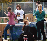 Citizens of the Billings community help each other make cardboard box homes on the Rocky practice football field. photo courtesy of Karen Beiser