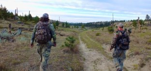 Kyle Behner and a friend on a hike during hunting season. Photo by Kyle Behner