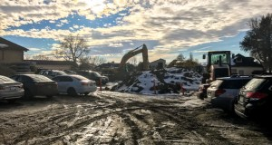 The Tech Hall Parking Lot remains crowded with construction activity, and students' vehicles. Photo by Riley Howard, Edited by Nicolas Cordero