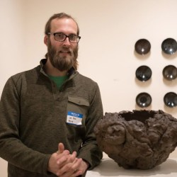 Red Lodge Clay Center resident Lars Voltz at the opening of a new exhibit at the Ryniker-Morrison gallery. Photo by Ean McLaughlin