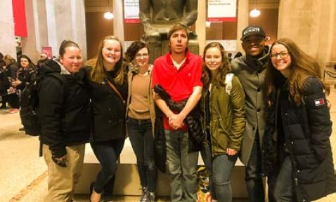 RMC students pose for a photo at the Metropolitan Museum of Art. From left to right: Sierra Hentges, Samantha Haan, René Bickel, Paul Quinn, Brianna West, Roman Jones, and professor Ashley Kunsa. Photo courtesy of Roman Jones.