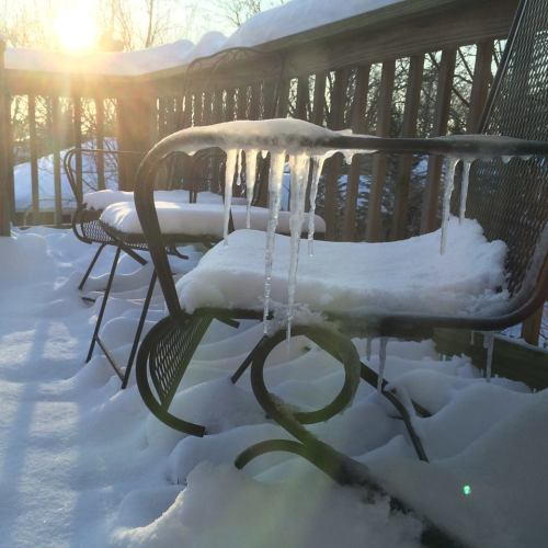 Sunrise on Ice...sun glow through icicles on back deck in February