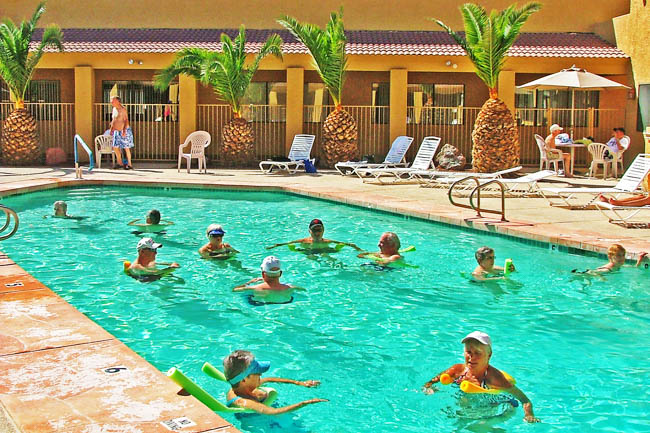 Residents enjoying the pool at Sundance 1 RV Resort