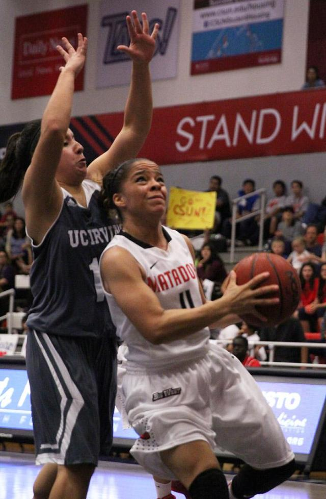Senior Cinnamon finds an opening to the hoop during the second half of the Matadors' game against UC Irvine on Feb. 21, 2015. (Trevor Stamp / Multimedia Editor)