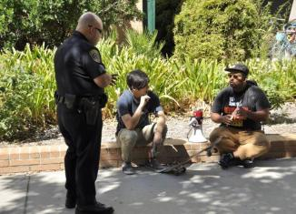 A police officer has a conversation with CSUN student.