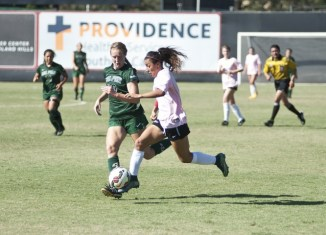 CSUN soccer player attempts to steal body away from Cal Poly soccer opponent.