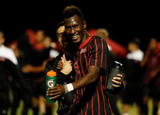 Sophomore CSUN soccer player celebrates with a fellow soccer member.