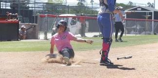 CSUN softball athlete slides into home base