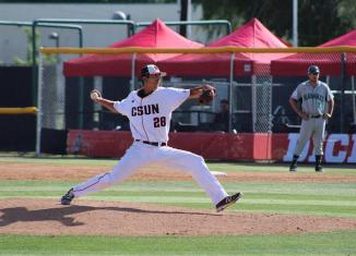 CSUN athlete pitches ball during a game