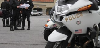 Police motorcycle parked in front of officers
