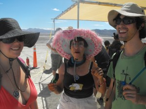 Lashes, son Eric and girlfriend Natalie soaking in the playa ambience.