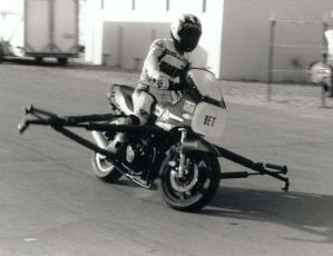 1994, the Brake Rig. Keith locks up the front wheel on his brake trainer device.